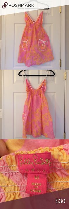 Lilly Pulitzer Jubilee Collection Lilly Sundress Lilly Pulitzer Jubilee Collection Lilly Sundress                 Beautiful orange and pink Lilly dress with dainty white straps that tie.  The dress has two beautiful tulip shaped pockets on the front of the dress.  Perfect for summer or a cruise.                             - Size: Medium                                                               - In perfect condition - no stains, holes, or tears Lilly Pulitzer Dresses Midi
