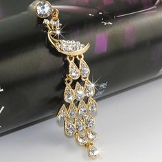 awesome iClover Lovely Peacock style Bling Crystal 3.5mm Rhinestones Cellphone Charms Anti-dust Dustproof Headphone Jack Plug for iphones, ipads, ipods- White