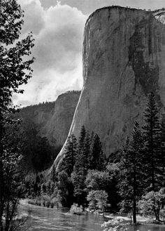 The huge bulk of El Capitan stands guard at the entrance to the gates of the Valley. This tremendous monolith of granite rises feet above the Valley floor, and is one of the famous landmarks of Yosemite.by Ansel Adams Ansel Adams Photography, Color Photography, Urban Photography, Famous Photographers, Landscape Photographers, Yosemite National Park, National Parks, Ansel Adams Photos, Sierra Nevada