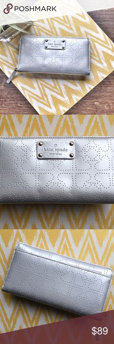 kate spade Metro Neda Continental Wallet Silver Kate spade metro neda zip wallet. Patent leather with delicate heart punches. WLRU1444 This continental wallet zips around to stow train tickets, movie stubs, and all the cash or credit you'd ever need to carry in its plentiful pockets and slots. Fits the largest iPhone plus. Also listed on vinted   -Continental wallet embossed pvc with patent pvc trim -Back exterior slip pocket. Zip around closure. -Center zip change pocket, 3 bifolds, 12…