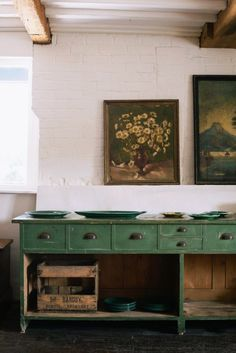 green home accessories kitchen with vintage floral paintings and rustic green sideboard with drawers and open shelving designed by devol kitchens. Green Furniture, Painted Furniture, Shelving Design, Open Shelving, Devol Kitchens, Vintage Sideboard, Kitchen Sideboard, Rustic Sideboard, Serving Table