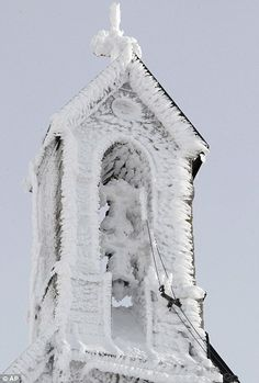 snow clings to the tower of the Wendelstein church, Germany's highest church, 1838 metres up on Wendelstein mountain near Bayrischzell, southern Germany
