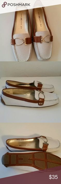 Anne Klein NWOT loafers New without tag white leather loafer with brown trim. Anne Klein flex.   Very comfortable  . Cute strap and buckle.  I bought these and brought them home and discovered I already had another pair just like them.  Oh well.  It happens.  Super cute and comfy. Anne Klein Shoes Flats & Loafers