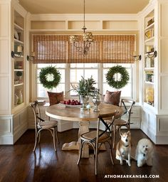 Love this little nook area with table and built in shelves....also love those two little pooches!