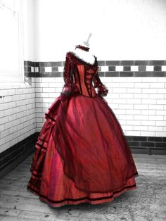 SparklyJem: Stunning Steampunk Style Wedding, another beautiful gown in red, same corset detail as the purple.  Love the sheer apron front of the dress with the tier bustle in the back!