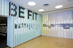 New Work: 'FitNation' A pattern of dimensional panels extending from the walls activates the space and frames the content.