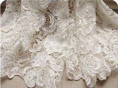 Graceful White Venice Lace Fabric Crocheted Hollowed Out Fabric 35 Inches Wide 1/2 Yard For Wedding Dress Veil Costume Supplies. $29.99, via Etsy.