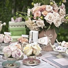 For the Parisian at heart viaThe Housewife WannabeOoh la la -- what bride wouldn't love an elegant brunch beneath the Eiffel Tower?  Tea cups and vases overflow with sophisticated roses, while tiny dishes hold  candy-coated Jordan almonds in pastel colours.