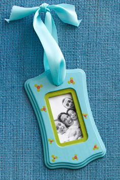 "I'm having a ""why didn't I think of that?"" moment! Plastic light switch covers are around 50 cents. Use mod podge and tissue paper to cover, and place photo in back."