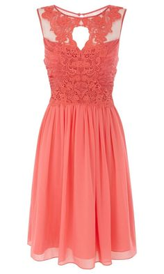 Stunning detailed bodice on this coral bridesmaid dress. Could even be worn by a guest with summery accessories.