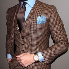 I have always liked combining pale blue and brown... I would have gone with a stronger handkerchief and perhaps a patterned brown tie
