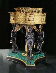 www.heuvelmans-interiors.com    Gilt bronze flowerbox with base in semi precious stone malachite style Empire