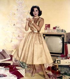 Elizabeth Taylor in a christmas advert for Ambush perfume, 1950s