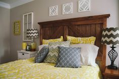 Home Decor | Our Master Bedroom | DIY Barn Door Headboard, Yellow and Gray Chevron and Ikat bedding and pillow