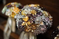 vintage brooch bouquets in silver, purple and gold.