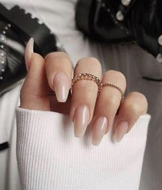 """If you're unfamiliar with nail trends and you hear the words """"coffin nails,"""" what comes to mind? It's not nails with coffins drawn on them. It's long nails with a square tip, and the look has. Blush Nails, Nude Nails, Glitter Nails, White Nails, Pink Glitter, Neutral Gel Nails, Nail Gradient, Solid Color Nails, Fall Acrylic Nails"""