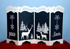 handmade Christmas card: Peace and Love by catluvr2  ... white and dark navey ... white die cut deer, sentiments and snowflakes with white embossed trees ...  gorgeous screen card ...