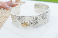 Bicolor bracelet with traditional rustic edelweiss