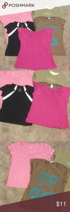 Bundle 5 tops 5 short sleeve shirts. They are all different sizes but fit the same. Last pic shows a small spot hardly noticeable. Rest are worn but in good condition. Medium best describes how all fit. Tops Tees - Short Sleeve