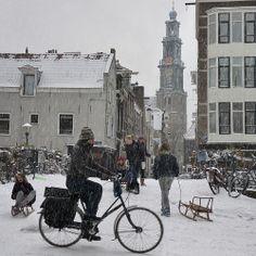 Sledding from the Hilletjesbrug in heart of Amsterdam