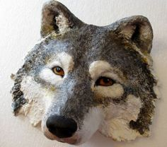 Video #6 -How to make a wolf mask with shop towel mache and my paper mache clay - this is the final video, showing how I painted the mask. It's a display mask, for the wall.