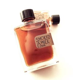 Smoked Amber Natural Perfume by Kenneth Cory-- This amber formulation includes several resins: labdanum, tolu, benzoin. As counterpoint to the sunny sweetness of the resins, a hint of smokey choya ral to the base. Indian spices marry with the lush floral heart notes of iris root, bitter orange blossom and golden champaca. Top notes include saffron, ginger, and Himalayan cedar for a bright opening.