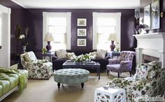 "In the Millbrook, New York, home of clients who love to entertain, designer Ashley Whittaker optimized the living room for mingling and socializing. ""The wheeled ottoman is easy to move, and there are lots of perches for party guests,"" she notes. The walls are in Fine Paints of Europe's G17150, a purple lacquer."