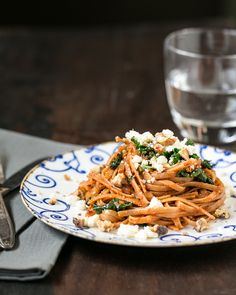 Roasted red pepper pesto linguine with kale and feta.