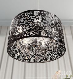Looks like it belongs in a French Creole courtesan's boudoir. Sexy filigreed black aluminum forms the shade of the Nebula Ceiling Lamp. Has a chrome base and a 40 watt bulb. Product Description • Prod