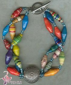 Kaleidoscope of Life bracelet. Made using recycled paper beads by a group of women in Uganda. 50% of the proceeds from the sale of this bracelet will go to Bead for Life, a non-profit organization that supports community development projects in health, education, employment, and housing to the impoverished in Uganda.