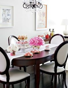love the shape of these chairs with the oval table