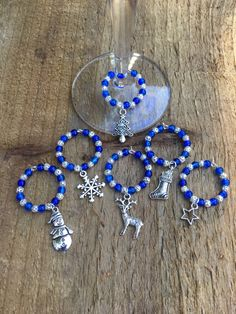 A personal favourite from my Etsy shop https://www.etsy.com/uk/listing/475790962/wine-glass-charms-blue-christmas-wine