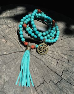 Introducing our NEW COLLECTION of Customizable Suede Tassel Crystal Mala Beads! This premium 108 bead mala is made of TURQUOISE HOWLITE & RED JASPER beads and is accented with bronze-tone spacers which are lead-free, iron-free. Length: 36. The 3 suede tassel is shown in TEAL, but may be customized to any other color of your liking. Simply select your desired color from the listings drop down menu. The OM symbol is the charm located on the back of the piece, which lands directly under the ...