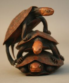 japaneseaesthetics:  A Japanese carved boxwood group of turtles...
