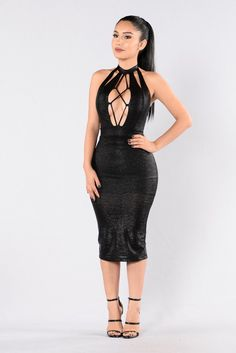 - Available in Black - Fitted Dress - Shine Material - Midi Length - Back Slit - Open Back - Halter Top - Chest Cut Out - Lace Up Front - Mock Neck - Made in USA - 95% Polyester 5% Spandex