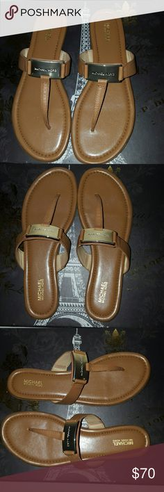 New Michael Michael Kors Colleen Sa dals New Mk Colleen thong sandals with original box, color: Acorn, round open toe slide on T strap flip flop sandals with gold tone hardware, vachetta leather, tumbled metallic leather uppers ruber sole. No trades. MICHAEL Michael Kors Shoes Sandals