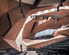 Tenerife architect Fernando Menis claims to have developed a new construction technique, demonstrated by this concert hall in Poland featuring faceted surfaces of crushed brick and concrete. Frank Gehry, World Architecture Festival, Interior Architecture, Theater Architecture, Innovative Architecture, Cultural Architecture, Interior Design, Amazing Architecture, Landscape Architecture