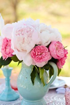 pink peonies and garden roses in light aqua