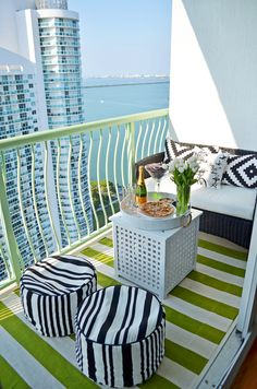 Outdoor Decor: Outdoor living can be a stylish extension of your living area. This small balcony was converted into a cozy space by adding a bold, striped rug from HomeGoods and comfy seating for lounging and entertaining. Tip: Pick a bright accent color and keep everything around it neutral such as black and white. This will create a refreshing modern space! (Sponsored Pin)