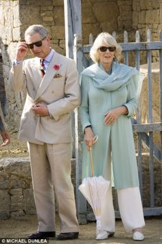 Prince Charles & Camilla. can*t hide behind those glasses guys ... we know who you are.. i love this pic its funny....