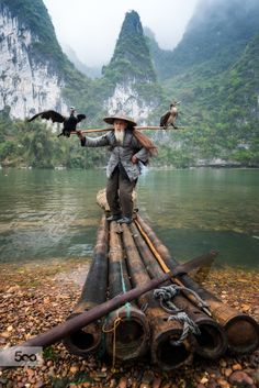 Thanks for viewing.. Hope you enjoy. His name is Huang whom I happen to share the same last name with; he is 83 years old, the older brother of the 75 year old fisherman I showed before.   From a recent trip to the iconic Li river in China.. These cormorant fishermen no longer fish for a living and only pose for tourists :) .. Their awesomeness and their special connections with the river as part of the history are still there though...