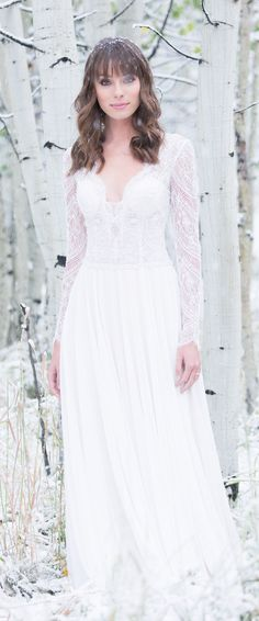 The perfect gown for winter weddings! Love the crocheted lace bodice! Gown style 9515 by @allurebridals #allurebridals #wedding #weddingdress #weddinggown #ad #laceweddingdress #gownoftheweek #winterwedding #winterbrides #romantic #lace