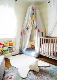 reading nook with twinkle lights and cloth banner - cute for a playroom or kid's room
