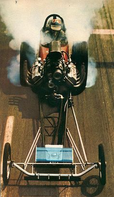AA Fuel Dragster. In the early days the engine was in front of the driver. Very dangerous if the blower blew up..