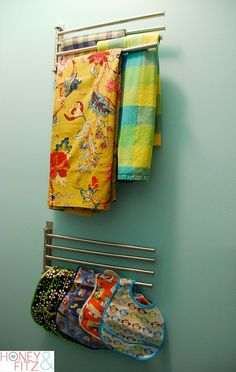 Love the idea of storing tablecloths and maybe cloth napkins and handtowels on these Ikea racks.