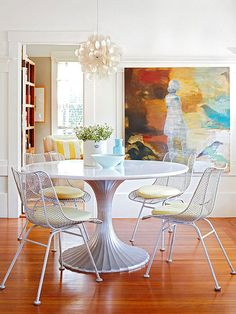 Table in front of doorway? Kind of works here. Large art piece fills negative space to balance out door.