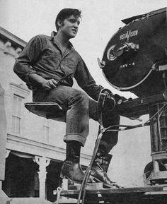 Elvis wearing jeans.