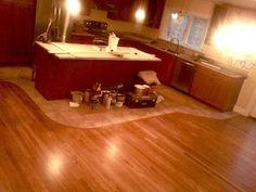 Curved transition around kitchen    cherry stain