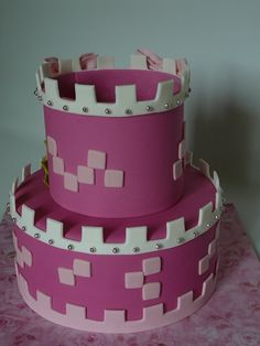 Princess castle - I made this cake for Princess Anabelle, 3 years old. The cake is vanilla with buttercream and fresh strawberry filling covered with fondant. The top part of the castle is fondant that I let dry so it can hold by itself on the cake. The details are also fondant. A real girly cake!