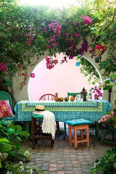 Tropical inspired patio look. Patterned tablecloth with lanterns and ecclectic seating. More ideas at www.redonline.co.uk